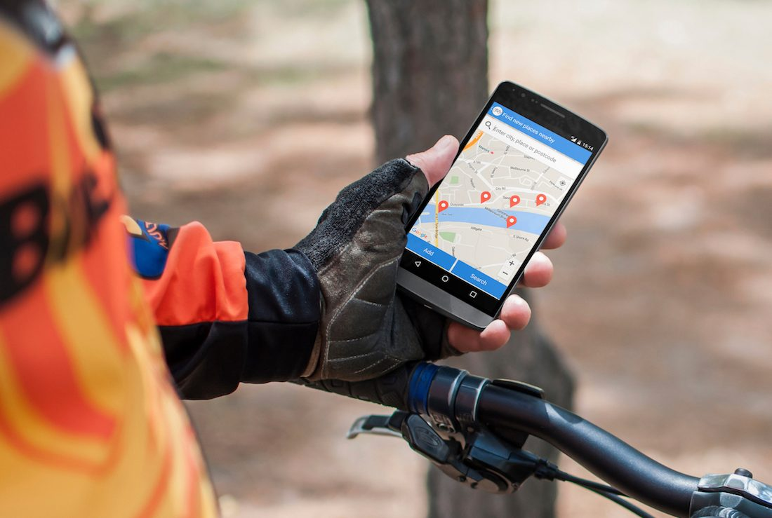 Cyclist holding phone displaying App Movement
