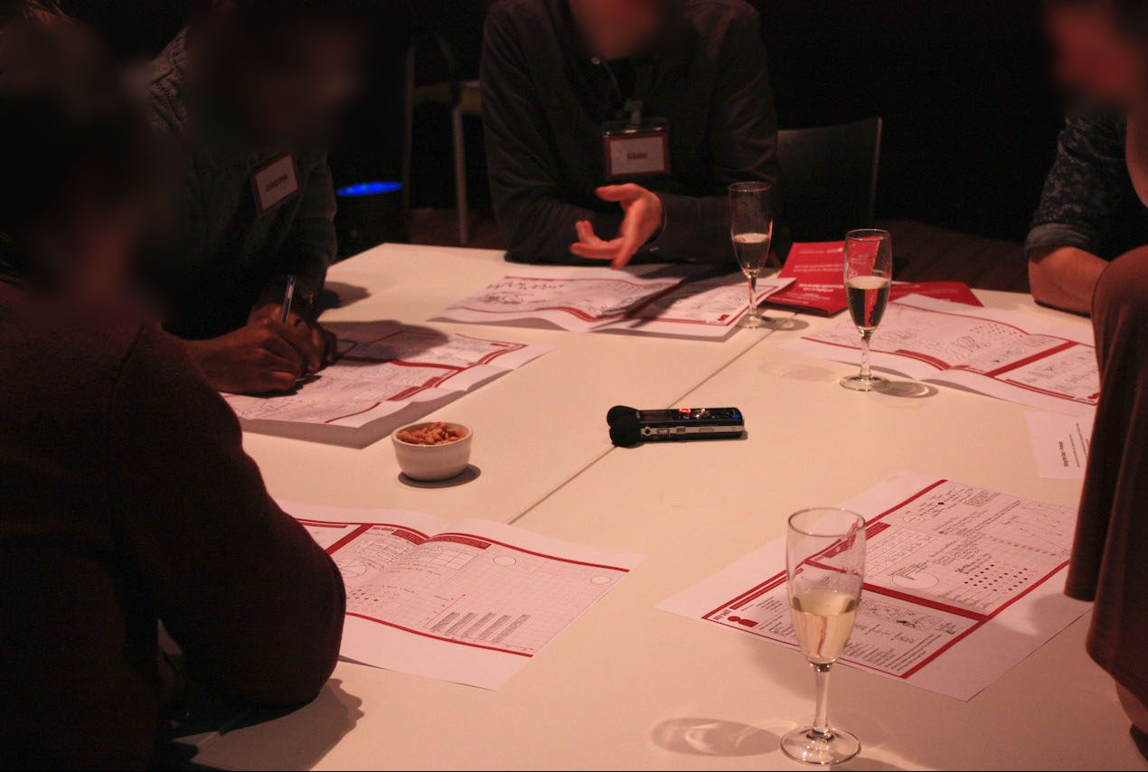 Participants sat round a table at a metadating event