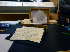 Handwritten book laid out on table