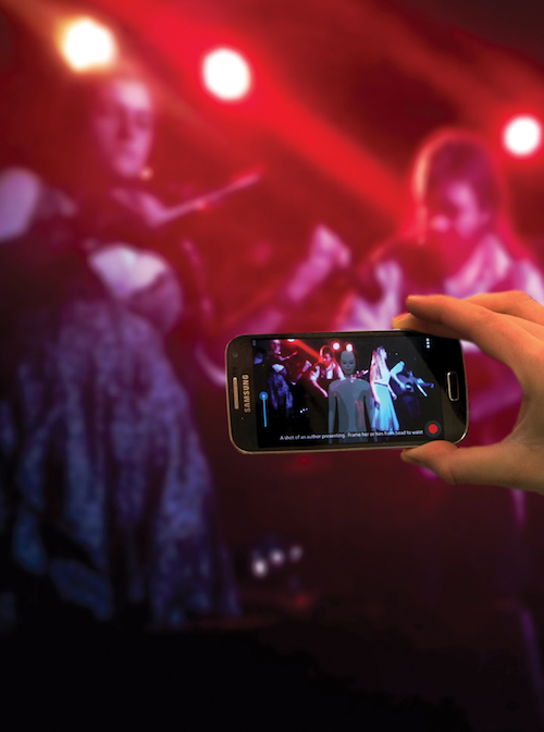 Man using Bootlegger on a mobile phone to record a live music performance