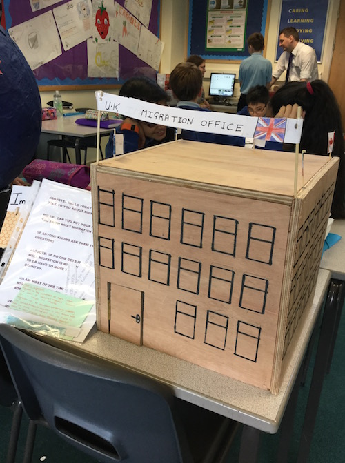 Cardboard model of an immigration office in a classroom